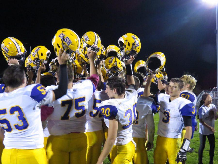 Helmets raised in victory